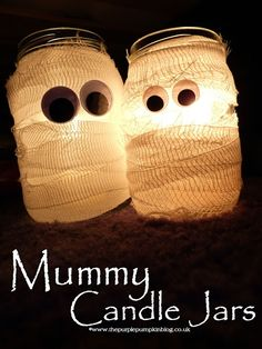 Cool Centerpieces or Night lights for the bathrooms during the Halloween party  ~Mummy Candle Jars {Crafty October} at The Purple Pumpkin Blog