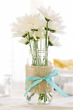 daisies in a jar with burlap and ribbon