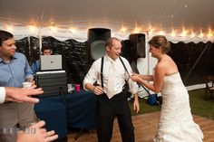 Bride pulling Groom's suspender while dancing. Reception party wedding photos at private estate at Preston, Easton, Eastern Shore, Maryland by photographers of Leo Dj Photography. http://leodjphoto.com