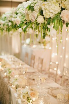 Classic white wedding with stunning floral installation: http://www.stylemepretty.com/2014/06/24/classic-white-wedding-with-stunning-floral-installation/ | Photography: http://www.onelove-photo.com/