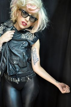 """Love Lady Gaga's arm tattoo It says: """"In the deepest hour of the night, confess to yourself that you would die if you were forbidden to write. And look deep into your heart where it spreads its roots, the answer, and ask yourself, must I write?"""""""