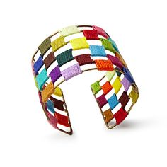 $28.00 Uncommon Goods A splash of handmade India on your wrist, this vibrant cuff features a checkerboard of brightly woven thread on an malleable lightweight iron bracelet. The bold colors and simple design bring eclectic flair on its own, or when paired with your favorite bangle bracelets. Crafted by women artisans in India working with a Fair Trade network, this versatile accent makes a chic statement while spreading the wealth. Handmade in India.