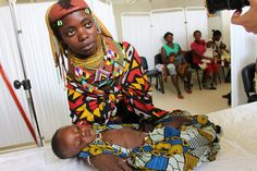 Yalua Ndama with her son, Namana Chanhamba, suffering from malaria and malnutrition, in a Lubango, Angola, health clinic.