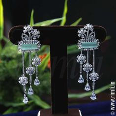 Dangler earrings in floral motifs with white & mint green stones. Wedding Jewelry And Accessories, Indian Wedding Jewelry, Jewelry Party, Fancy Jewellery, Indian Bridal, Bridal Jewelry, Hair Accessories, Indian Jewelry Earrings, Diamond Jewelry
