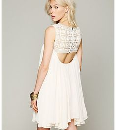 Free people white dress with a cut out back.