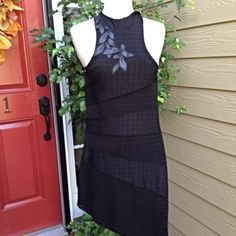"Free People Dress Sheer, hi/lo, black lace dress with flower appliqué at neckline. Polyester and spandex fabric. You need a nude or black slip under this, unless you are really daring. Says medium but fits like a small! 32 inches long at shortest point. Probably 2 inches longer at longest point. Bust is 30"". Sexy!🎀 Fits more like a small than a medium. Free People Dresses"