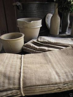 Everyday items carefully chosen, artfully arranged and skillfully lighted become gorgeous. Neutral Colour Palette, Muted Colors, Rustic Elegance, Rustic Style, Gris Taupe, Linen Store, Linens And Lace, Everyday Items, Vintage Textiles