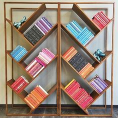 Miron Lior's inventive design angles to add interest to any size space. Open solid-teak frame braces seven slanted shelves in rich wood tones and active grain. Alternating angles create an airy, uncluttered silhouette to beautifully break up a large room or divide a small studio. Displays books and disguises clutter. Double them up for added drama.