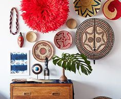 To get a well-traveled, richly textural look, hang pieces that look as if they were picked up on far-flung journeys. Feathered headdress, anyone?