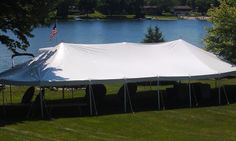 Open 30 x 60 oval tent on a lake front. 844-TENT PRO