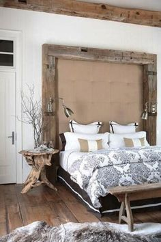 Headboard ideas to improve your bedroom design  This bedroom has a very rustic, upscale cottage feel with the help of all that beautiful natural wood used throughout. The warm tone and textured animal rug add instant comfort while the beautiful bedspread ads a elegant factor. A great balance.  - L
