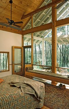 bedroom with window wall opening onto porch