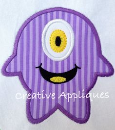 Round Smiling One Eyed Monster Machine by Creativeapplique on Etsy, $4.00