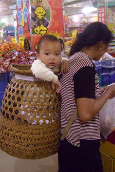Baby in Basket Carrier, Qiuchang, China. Photography by Cowyeow
