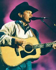 "George Strait--This looks just like I remember the concert...with the magenta light shining on him while he sang ""Hello Darlin"" and I cried buckets."