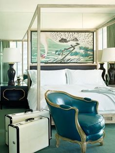 confident interior. I love the all white bedding with the unexpected teal leather chair.