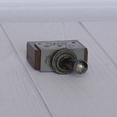 Toggle Switch, electrical switch, switches toggle, soviet switch, vintage switches, electrical supply, industrial decor, on off switch. Produced in USSR in 1973. Designed for 220V, 5A. Good vintage condition. The toggle switch was not used. All photos are real. Measures: