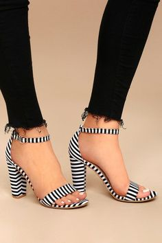 The Veda Black and White Striped Ankle Strap Heels are here to impress! Beautiful striped fabric shapes a minimal toe strap and adjustable ankle strap (with gold buckle).