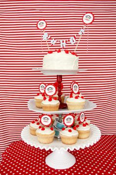 Adorable cupcake tower made by Emily for her son Kohen's birthday, via Apartment Therapy. #paulfrank #julius #party #cake #cupcakes