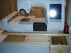 Singer embroidery machine on riser with drawer