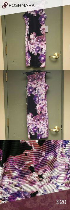 Jennifer Lopez floral midi dress NWT. Gorgeous purple floral print. Fitted style, length hits just below the knee. Great for work or a night out! Jennifer Lopez Dresses Midi