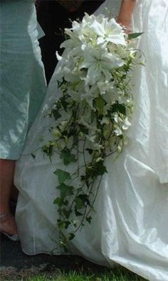 Image result for brides bouquets in red with ivy