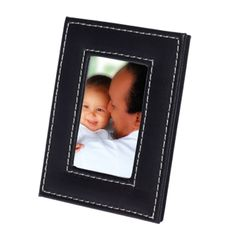 Small Leatherette Photo Frame Features Leatherette Finish White Contrast Stitching Holds 5cm x 7.5cm Photo