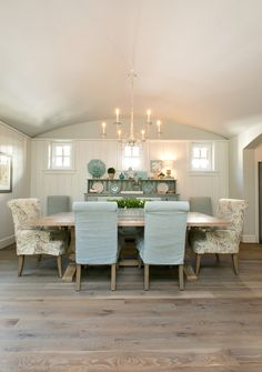 Create Coastal Style- Bare floors are a staple of coastal style. When you've got sandy feet to deal with, the last thing you want is carpeting in the home. This beautiful dining room also adds the soft colors of the blue sea and tan sand ! by http://town-n-country-living.com/