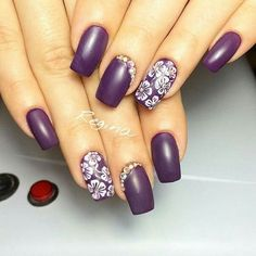 Purple nails with white flowers