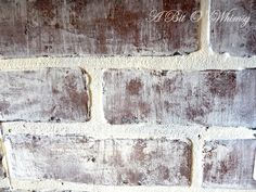 """I wanted more of a worn and weathered """"real brick"""" feel for my $23 home depot faux brick price. I got on Google and ran across this tutorial. She has a great video tutorial on a dry brush painting technique for her brick. I just used white latex paint I had on hand. I painted all the grout lines white with a small brush. Then I watered down a small amount of white latex paint, dipped my dry paint brush into the paint, and dabbed it onto a clean dry cloth to get off any excess paint. I found…"""