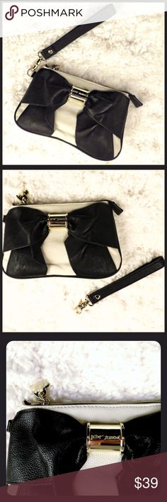 """Betsey Johnson Cream Black Bow Wristlet Clutch GL Cream color wristlet with Black Bow & removable wrist strap.  Size approx 5.5"""" Height x 9"""" Length.  Zip closure.  Very gently loved with minor use (2-3 times). Betsey Johnson Bags Clutches & Wristlets"""