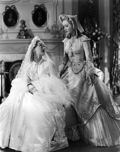 Bette Davis and Miriam Hopkins in 'The Old Maid' (1939). Costume design by Orry-Kelly. The time period is 1860s America.