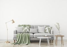 Scandinavian style livingroom with fabric sofa, pillows, plaid, lamp and green plant in vase on white wall background. - Buy this stock illustration and explore similar illustrations at Adobe Stock Columbia River Gorge, Fabric Sofa, Sofa Pillows, Plaid Fabric, Range Cable, Scandi Living, Best Interior, Interior Design, Interior Decorating