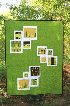 This gives me an idea: Polaroid quilt! Fussy cut some center squares with a white border that is slightly thicker on the bottom.