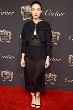 Rooney Mara in a black sheer dress and cropped black bomber jacket