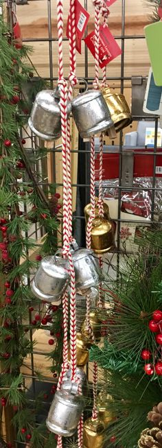 A festive door chime. Or... a home made alarm system to keep little ones from Checking up on Santa. Hahahahahah. - jennifer   Bells, Christmas, Alarm System, Santa Alarm, Santa Clause, Christmas, Christmas decor, Christmas bell, Christmas bells, Silver bells, World Market
