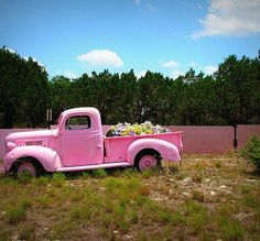 Pink truck with flowers
