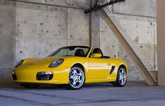 Boxster (986 & 987)    Year: 1996-present    The lowly Boxster—internally designated the 986—helped save Porsche from bankruptcy in the mid-1990s. It uses the same mid-engine architecture as the 550 Spyder and remains one of the best sports cars of all time, with better inherent driving dynamics than the 911. Early models were underpowered and had shoddy interiors. Porsche fixed the former with a more potent S model in 2000.