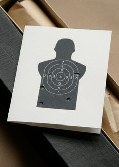 """Funny Miss You Card-- I made it and it turned out really cute!  You can find the shooting target under google images. I used a tiny screw driver to make the holes, but I did them actually """"missing"""" the target because I thought that made more sense and looked cuter that way."""
