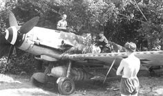 Asisbiz photos of The Messerschmitt Bf 109 in a nutshell,Messerschmitt Bf Stab Josef Wurmheller with Walter Oesau looking on France Ww2 Aircraft, Fighter Aircraft, Military Aircraft, Luftwaffe, B 17, Erfurt Germany, Mustang, Ww2 Planes, Military Pictures