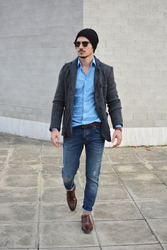 Wear a charcoal knit blazer and navy destroyed jeans to achieve a dressy but not too dressy look. A pair of dark brown leather oxford shoes will bring a strong and masculine feel to any ensemble.  Shop this look for $249:  http://lookastic.com/men/looks/beanie-sunglasses-longsleeve-shirt-blazer-belt-jeans-oxford-shoes/4987  — Black Beanie  — Black Sunglasses  — Blue Print Longsleeve Shirt  — Charcoal Knit Blazer  — Dark Brown Leather Belt  — Navy Ripped Jeans  — Dark Brown Leather Oxford ...