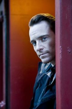 Michael Fassbender - O, this photo is great; there is something about his eyes, his face peering from behind the door ... like he's inviting you in ... gives me the shivers; I'm mesmerized.