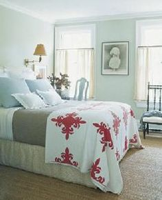 Mint bedroom with red accents. Doing this.