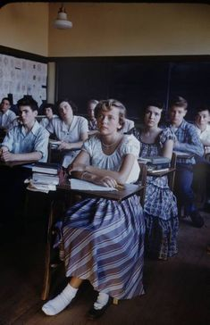 New Trier High School - 1950... Notice the slight changes in the classroom compared to classrooms today.  All of the students in this classroom are white.  This was a typical classroom in the 1950's.  It was not until a few years later that schools started to integrate.