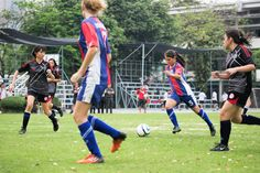The ball at her feet N. Wilson runs forward at pace to find her attackers.