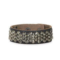 Maura Bracelet  Leather accessories never go out of style. Channel your tough chick chic with this black leather bracelet with anthracite studs.