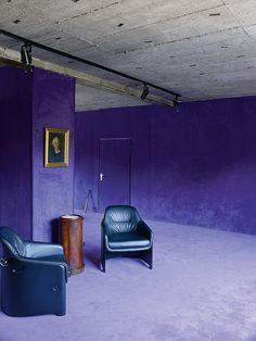 """... a soft purple carpet custom-made by the historic German producer Vorwerk extends across the floor and up the walls to meet a rough concrete ceiling. 'We always liked the rich color palette of Milanese apartments,' Koch says, 'but cannot deny our Teutonic fascination with industrial design.'"""