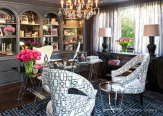 glamorous office space, designed by Jeff Andrews. Smoky grey laquered shelving and bookcases, geometric patterned chairs