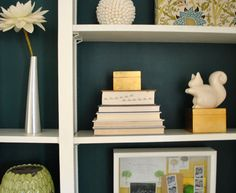 Such a great inky blue-green color for the walls or the back of a bookcase or built-in
