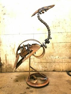 Firefly Welding The Sculpture Up Using Vintage Agricultural Or - Artist creates incredible sculptures welding together old farming equipment